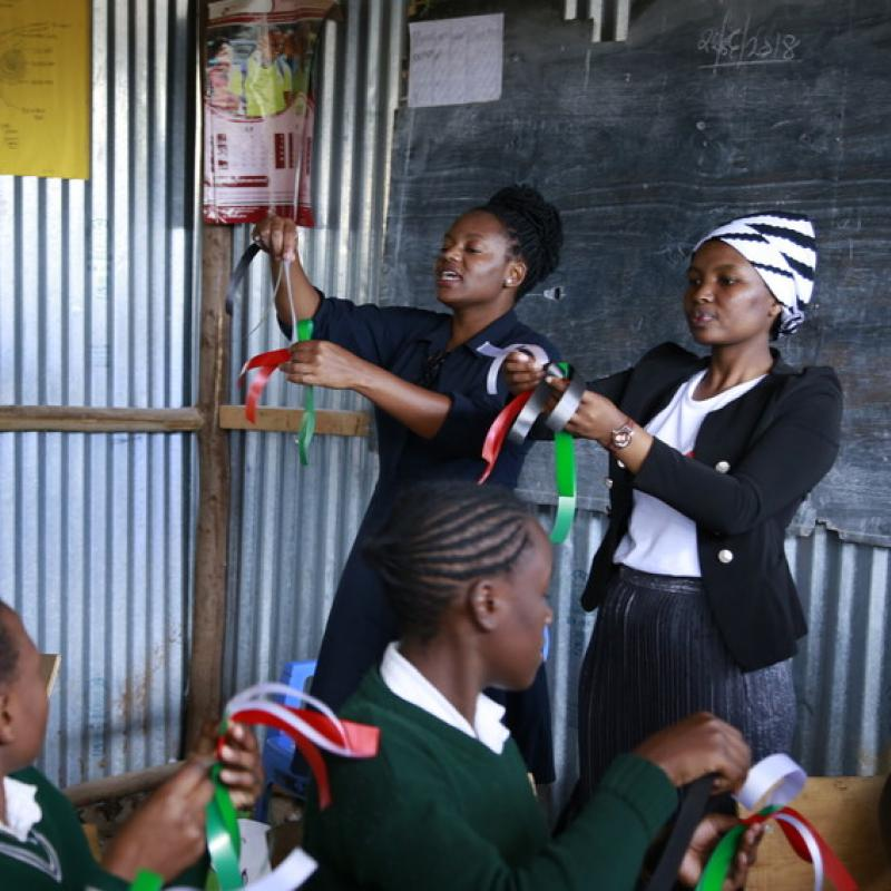 Gladys Muthara, 29, and Susan Waruingi running a workshops with teens from the Nairobi slums