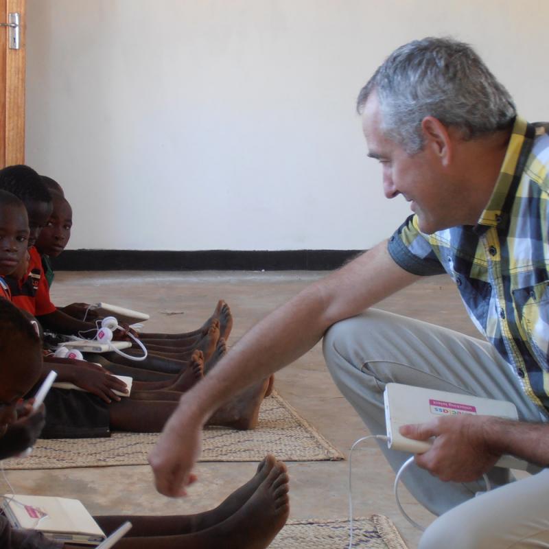 Education volunteer Fred van den Brug supporting children with Unlocking Talent resources
