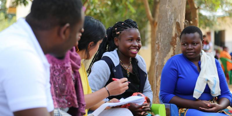 VSO national volunteer Jackline Kakala smiles as she conducts an aspirations analysis with young women participating in the Lake Zone Youth Empowerment project