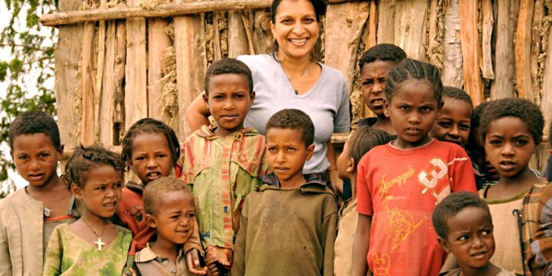 Julia Lalla-Maharajh with children in Ethiopia