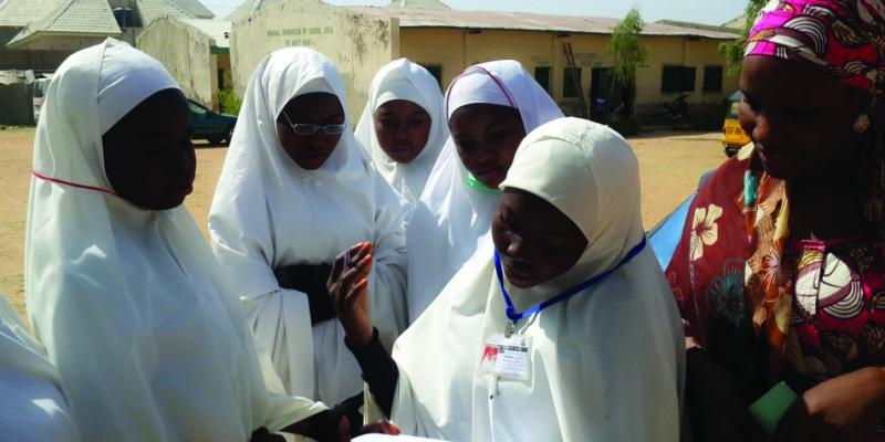 Children complete surveys in Kano, Nigeria