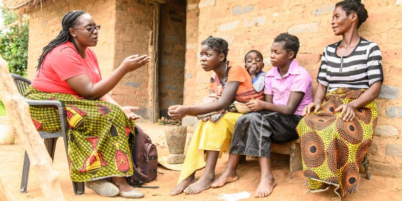 Volunteer Monica speaks to young people in Luapula district Zambia
