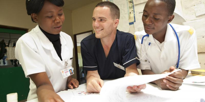David Atherton with his students Diana Liphana and Stevien Saiwala. David, THET programme VSO volunteer at work in St Lukes Hospital, Zomba district, Malawi