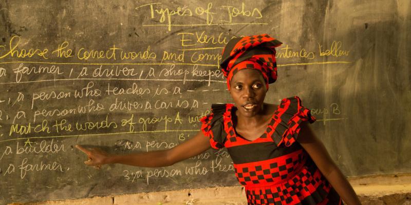 Teacher in classroom in Rwanda