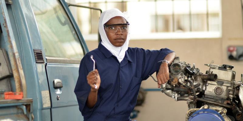 Young female motor vehicle mechanics trainee with wrench | VSO
