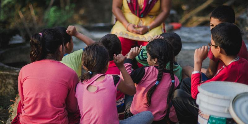 Children listening to a story in Nepal   VSO