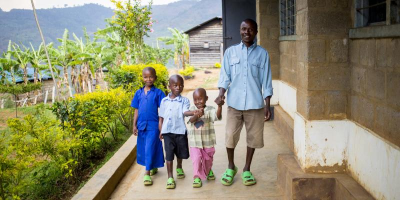 Father and children at primary school in Rwanda | VSO