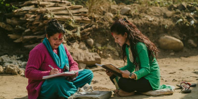 Durga (Big Sister) helping Nirmala (Little Sister) with her school work