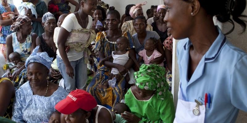 People wait at a clinic in Sierra Leone