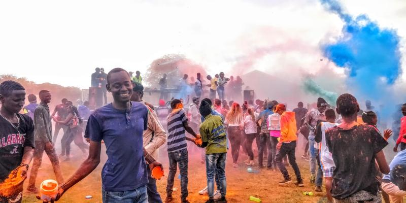 Members of the community of Loitokitok, Kenya take part in the ICS-organised 'Colourfest', a brightly-coloured, messy celebration of International Youth Day.