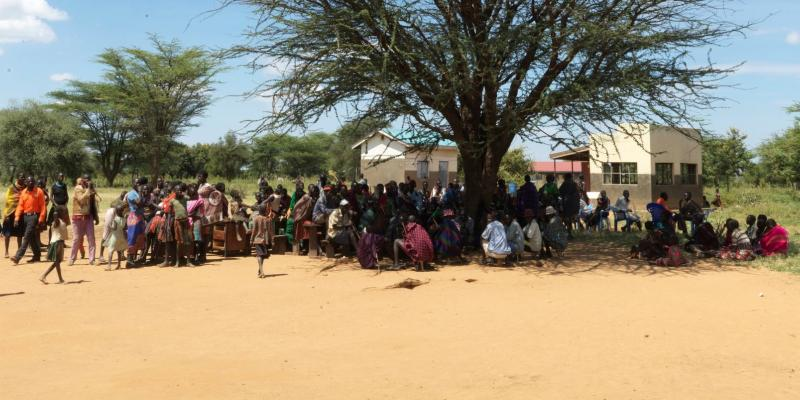 Parents attend a meeting where teachers and VSO volunteers have prepared a special programme about children's right to education at Acherer Primary School in Moroto.