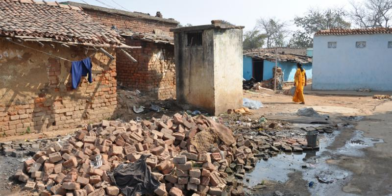 Woman walks through a slum of Ranchi, India   CSO