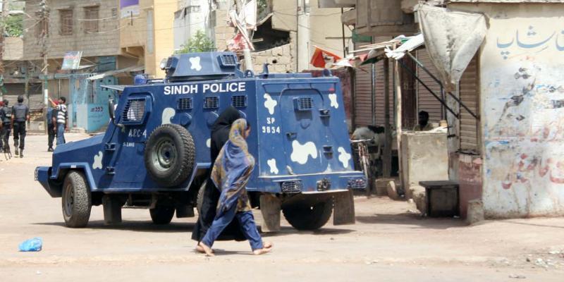 A police vehicle stops in a neighbourhood in Karachi, Pakistan