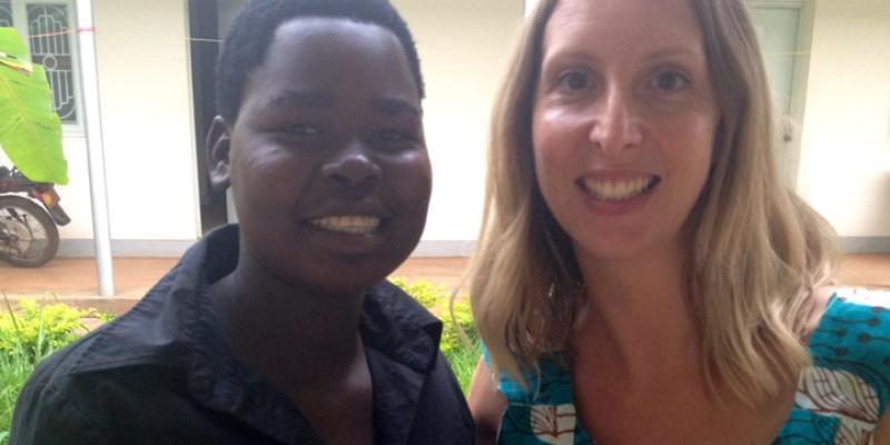 Volunteer Samantha and bricklaying graduate Brenda in Uganda | VSO