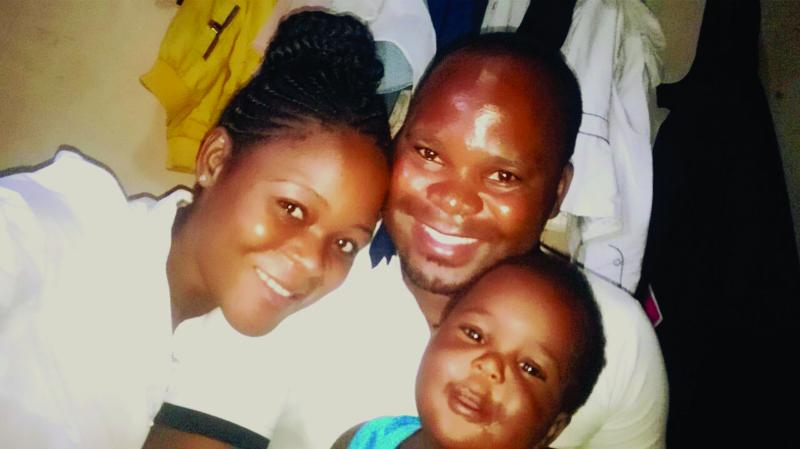 Chrissy Zimba with her partner and son