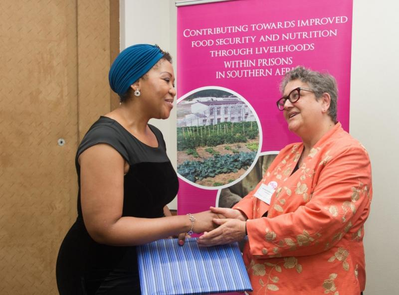 First lady Tobeka Madiba Zuma receives an award from Baroness Barker on behalf of VSO-RHAISA