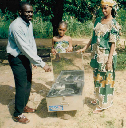 George Awalla is pictured here with a solar rice cooker in Nigeria in 2000.