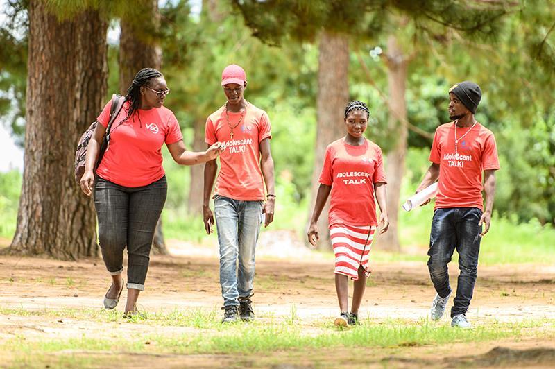 Volunteer Monica with peer educators