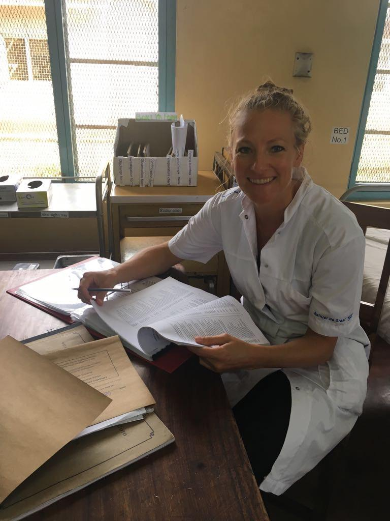 Janneke Burgers, 35, is pictured here sitting in Ligali hospital while on shift training doctors.