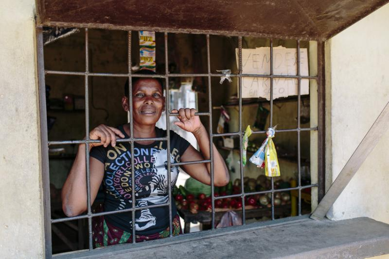 Woman stands in her barraca shop in MOzambique | VSO