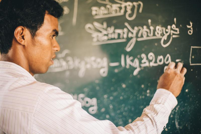 Teacher at a blackboard in Cambodia