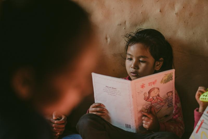Young girl reading in Nepal | VSO
