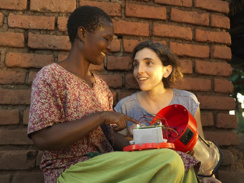 VSO volunteer with a woman solar engineer in Malawi