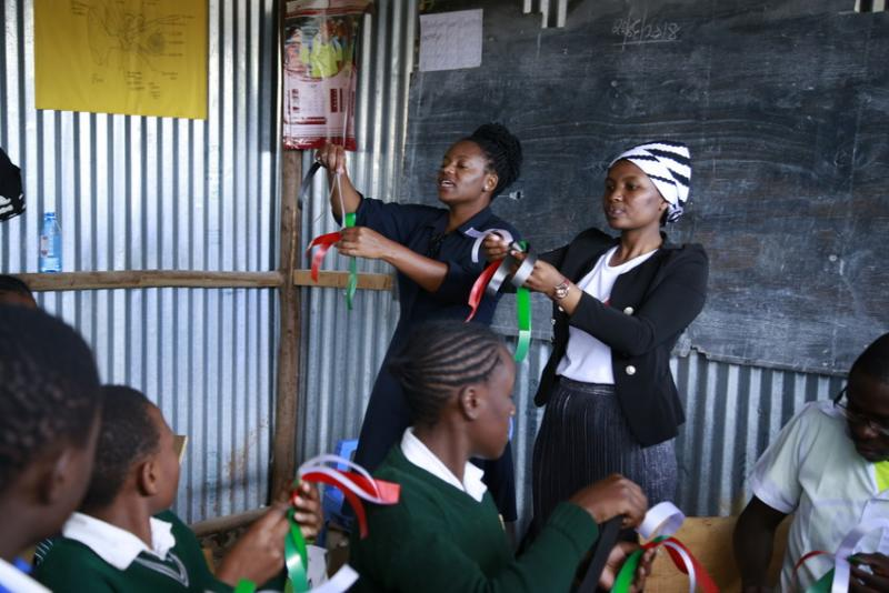 Gladys Muthara, 29, and Susan Waruingi running a workshops with teens from the Nairobi slums