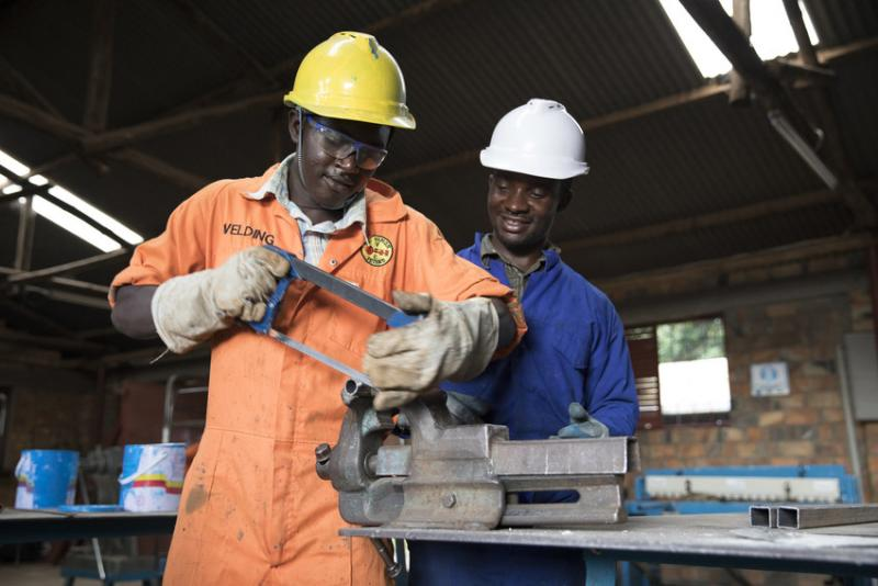 Whycliffe coaches one of his students at St Simon Peters Vocational Training Institute
