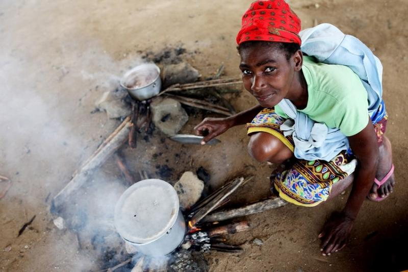 A woman prepares food for her family