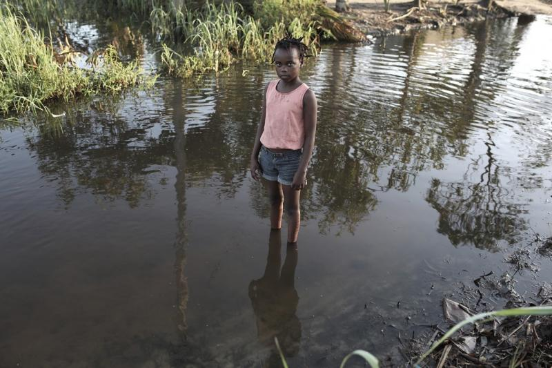 A child stands in floodwaters in Mozambique