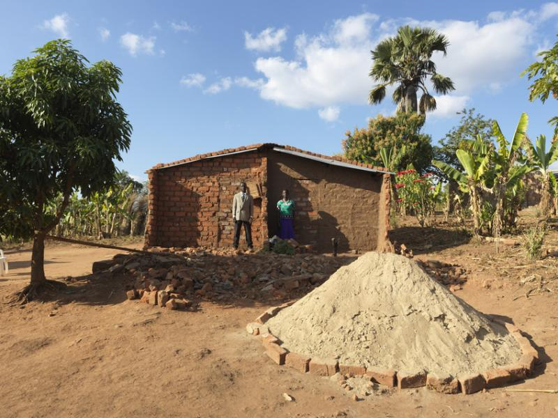 Mr. Arone Armando, 56, and his wife Margarida, 45, in front of their destroyed home after Cyclone Idai. Mudjacure locality, Macate district, Mozambique