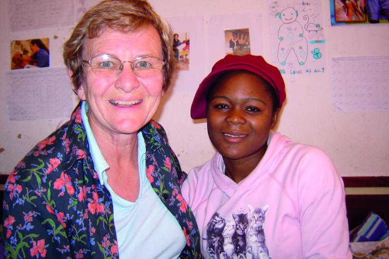 Sheila Lawrence (left) and Chrissy Zimba (right), together at a reunion in 2008 in Mzuzu, Malawi