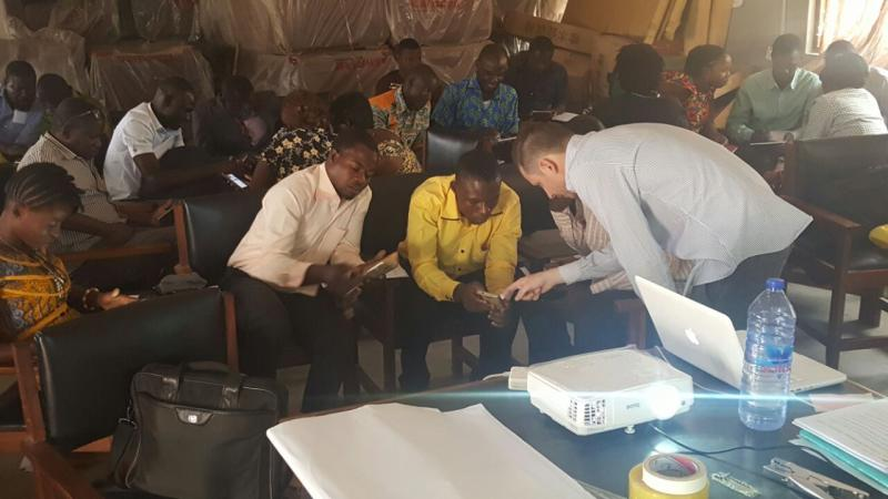 VSO volunteer Tom working with teachers in Ghana