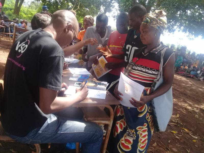 VSO volunteers organising food supplies for distribution